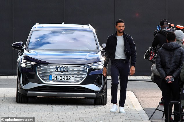 Dressed in matching navy-blue trousers and jacket, the actor, who shot to prominence last year as the Duke of Hastings in the Netflix period drama Bridgerton, was pictured next to one of the company¿s £40,000-plus Q4 e-tron cars