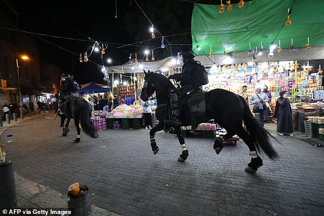 Some Palestinians threw stones and bottles as police on horseback dispersed the crowds, though the violence appeared less intense than on previous nights