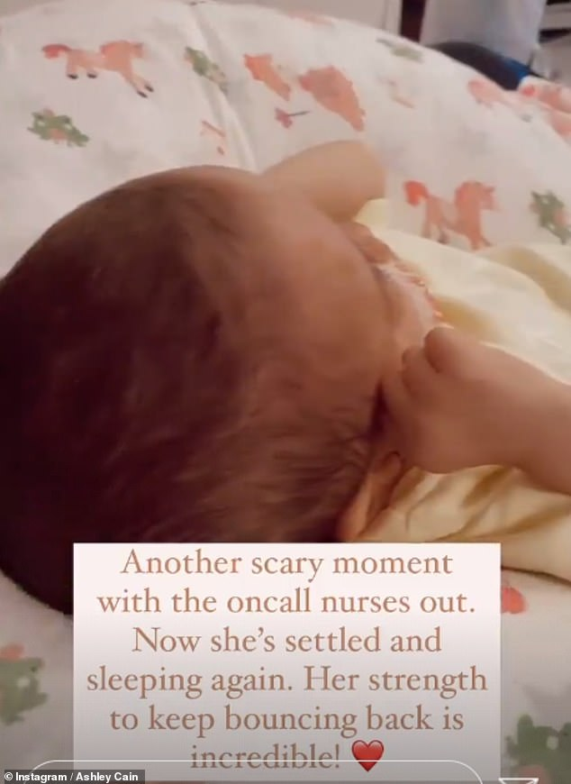 Ordeal: Later, Ashley also shared a video of his daughter settled next to him in the living room, writing: 'Her strength to keep bouncing back is incredible!'