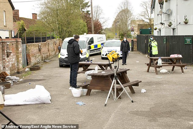 Two women and a man were taken to hospital when a camping stove exploded in a pub garden while apparently being used as a heater by customers. Pictured: Police at the scene today