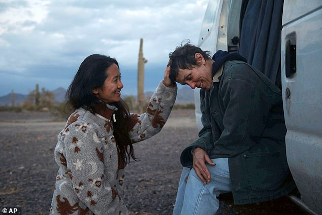 Frontrunner: Nomadland director Chloé Zhao is the frontrunner for best director, and her film is also a top contender for Best Picture; seen with Frances McDormand on set