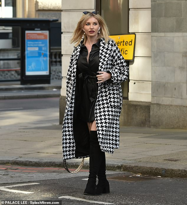 Here she comes:The Love Island star, 28, exuded style in a houndstooth coat paired with a striking leather mini dress and over-the-knee boots