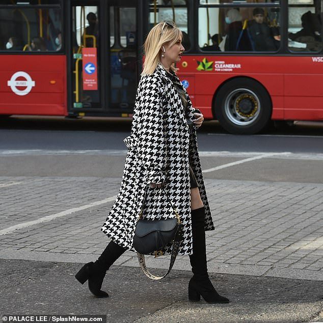 Style: Amy added a designer touch to her ensemble by toting a black Dior saddle bag