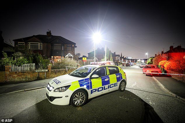A police car is parked near the scene inPeveril Road at around 8.15pm on Wednesday
