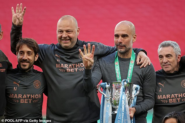Pep Guardiola celebrates with his coaching staff after winning the Carabao Cup on Sunday