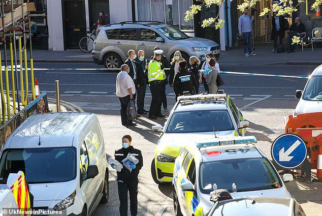Officers were called to an M&S car park on Church Street in Walton-on-Thames at 2.15pm on Thursday (pictured at the scene)