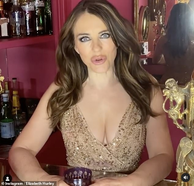 Stunning: The actress,55, flaunted her ample cleavage in a plunging gold dress as she shared a short clip encouraging others to join her at the virtual event to Instagram