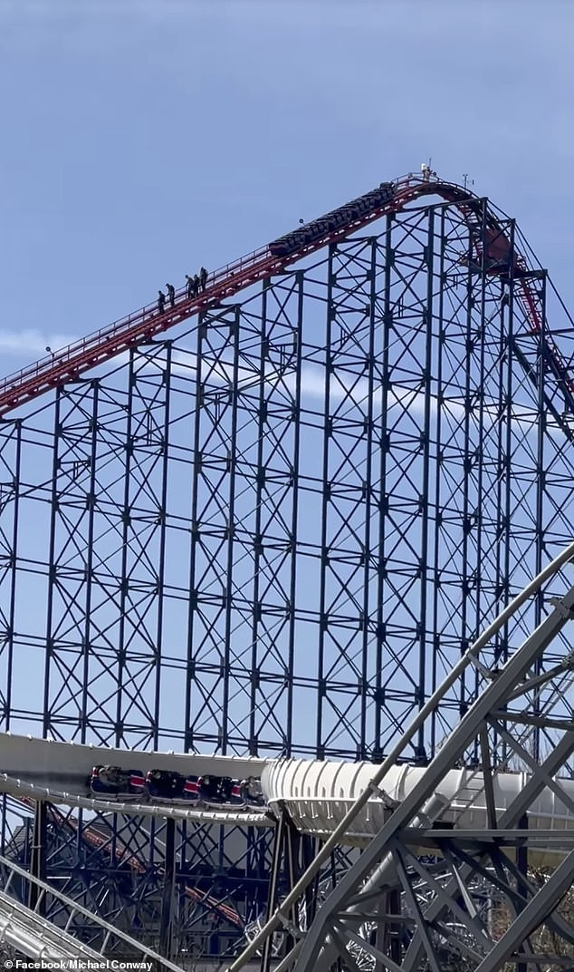 Park staff were forced to scale the rollercoaster before tentatively guiding nervous visitors to safety by making them walk down