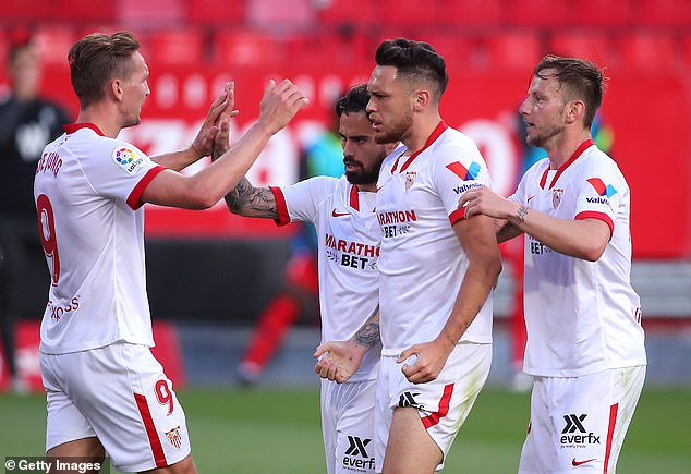 Sevilla forged a two-nil lead with strikes from Ivan Rakitic (right)and Lucas Ocampos (middle)