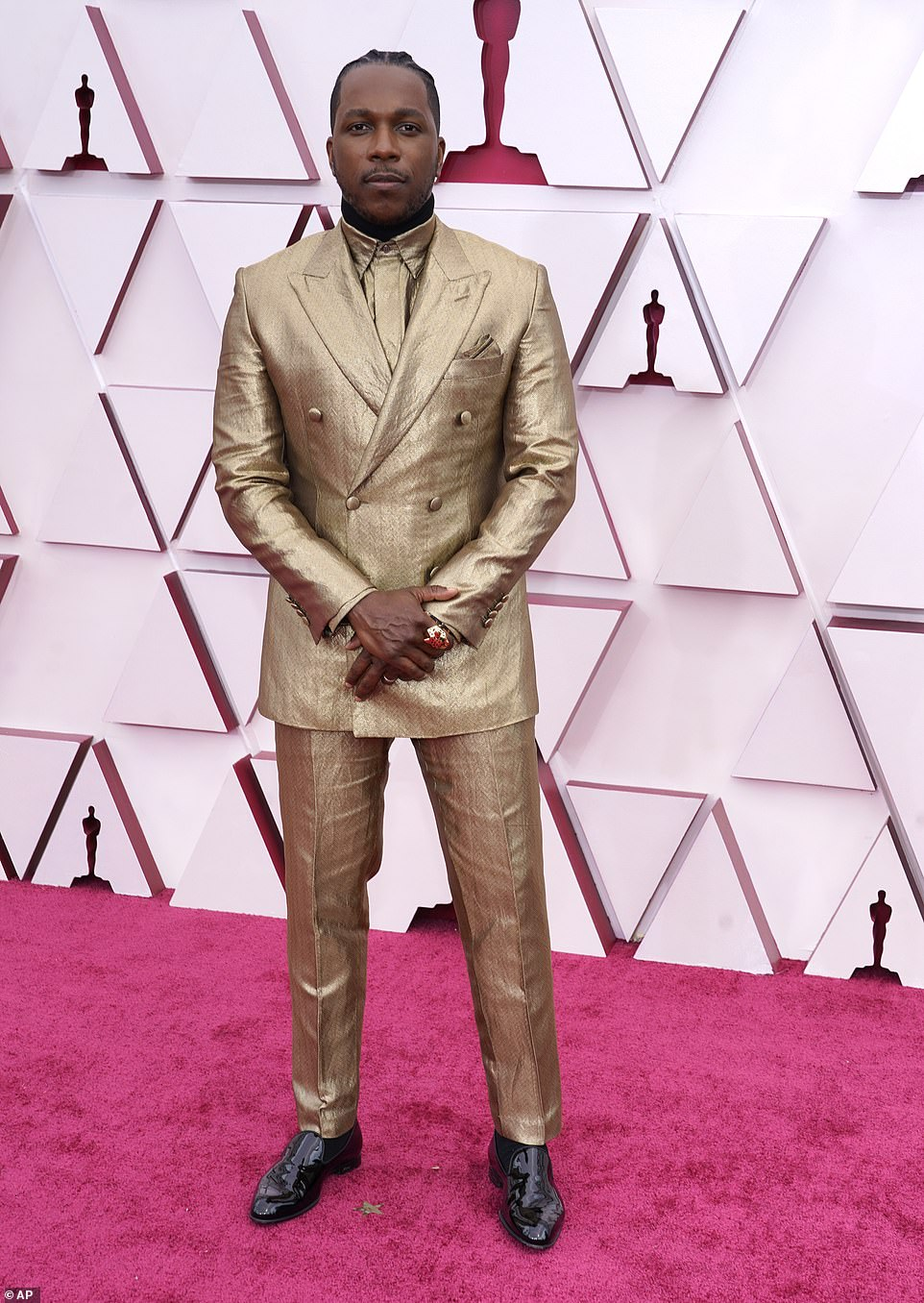Dapper: Leslie Odom Jr. rocked a gold suit, complete with a matching button-up beneath; Leslie is nominated for two Oscars: Best Supporting Actor for his role in One Night in Miami and Best Original Song for film's main song Speak Now