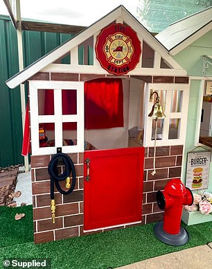 Kymberleigh Krzysztofiak, 28, from Perth, spent just $763 on the dream toy for her one-year-old son, Timmy, and the street encompasses a fire station, police station and a café in between them (buildings pictured)