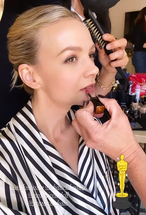 Behind the scenes: Before the event Carey had her hair and make-up professionally done