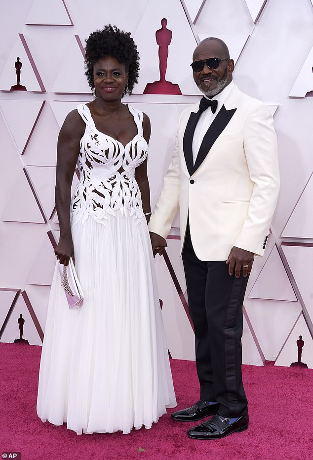 Happy couple:Viola Davis and her husband Julius Tennon held hands as they walked the carpet ahead of the ceremony
