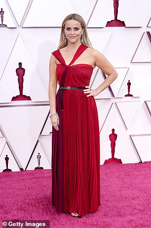 Standing pretty: Reese added a stylish thin black leather belt at her waist, also from Dior as seen in the golden buckle