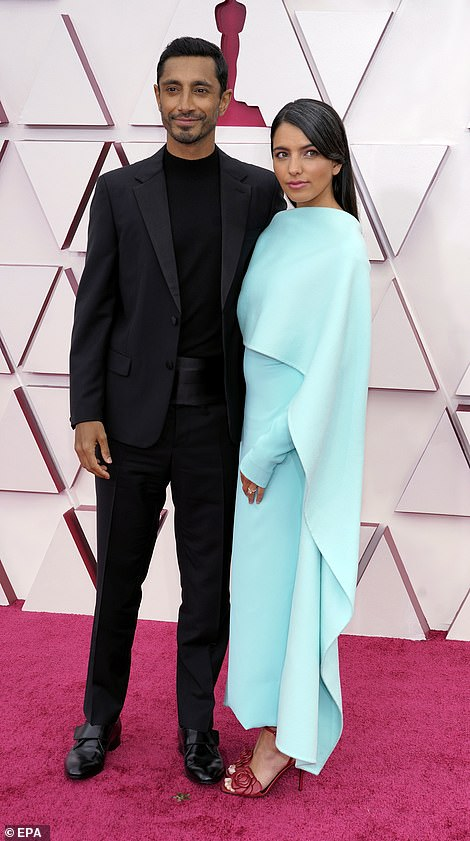 Handsome: Best actor nominee Riz Ahmed, 38, looked dapper as he arrived at the ceremony with his wife Fatima Farheen Mirza, who stunned in a turquoise blue gown and red heels