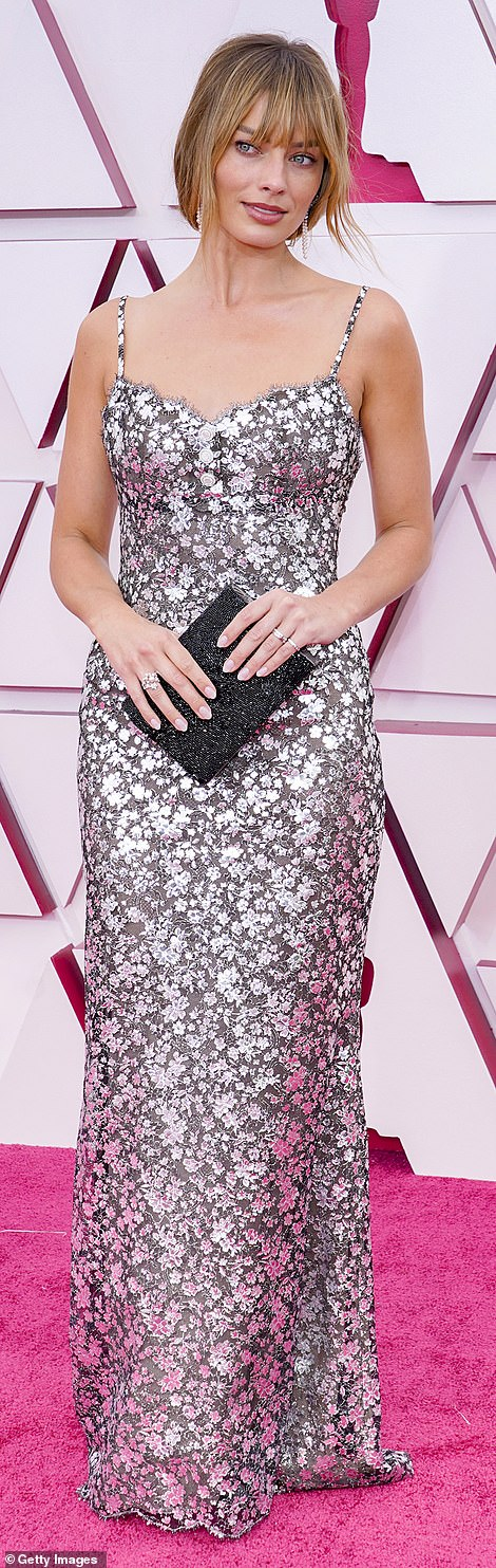 Margot Robbie donned a Chanel gray and silver gown featuring delicate floral detailing
