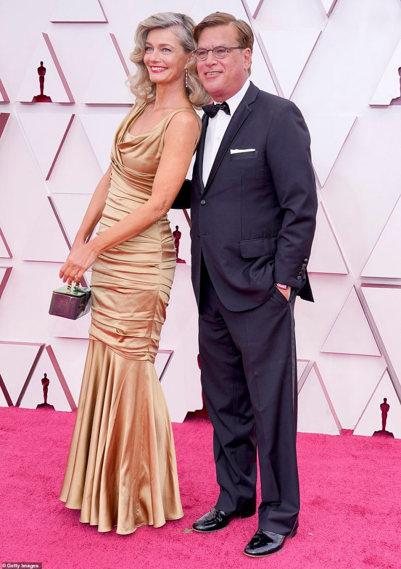 Lovebirds: Aaron Sorkin pictured on the red carpet with Paulina Porizkova, who donned a silky gold dress