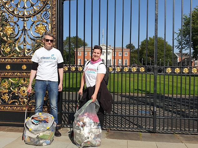 Anna Lund (RIGHT) and husband Ben , part of Warrington  litter picking Clean Up My Community. Seen in front of gates of Warrington Town Hall