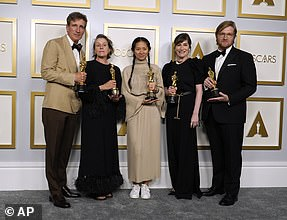Golden:Frances McDormand, Chloe Zhao, Mollye Asher and Dan Janvey (seen left to right) as Nomadland won Best Picture