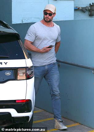 Keeping it casual: The Hollywood heartthrob stepped out in a pair of light blue jeans, a grey T-shirt and ecru-coloured sneakers