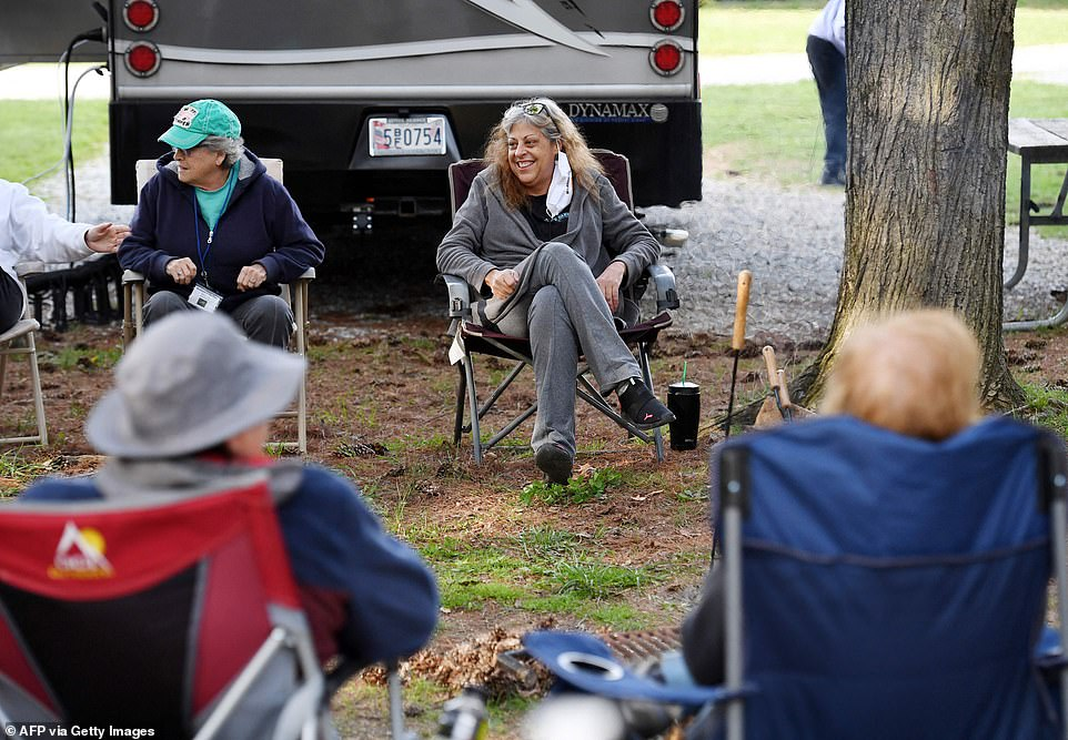 Kathy Wardell center, smiles with other members who are part of the mid-Atlantic chapter of a group called RVing Women. The group is made up of modern nomads, who find themselves living in their vans and travelling around the American hinterland