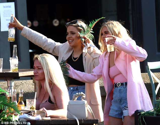 Cheers: Drinkers in Leeds headed to bars and beer gardens to enjoy the sun