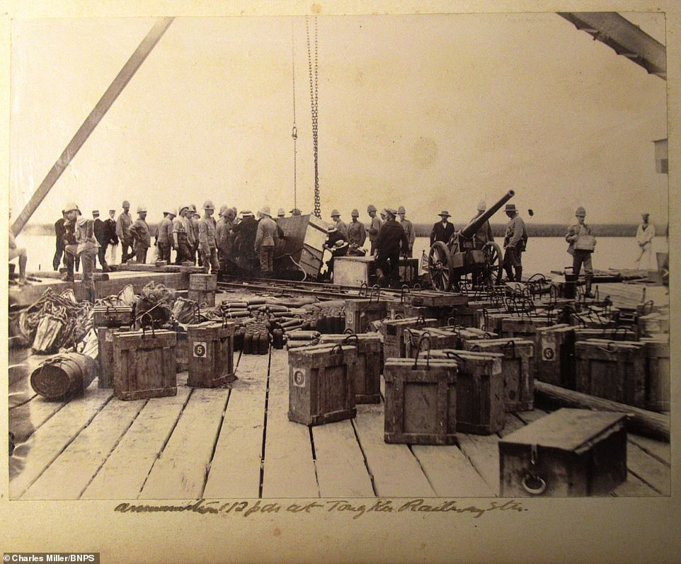 Troops from HMS Terrible are seen in South Africa with their weapons in the foreground. Captain Scott was appointed as the military commandant after arriving at Durban. As well as re-purposing the guns, Scott also adapted a small signal light so it could be used to communicate with forces which were besieged in Ladysmith