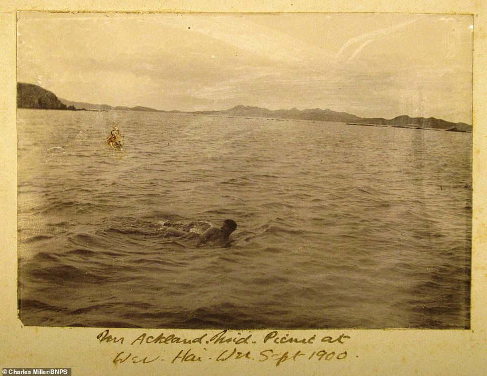 Dorling's images also showed the crew of HMS Terrible enjoying some down time. Above: A crew member takes a dip in 1900 after a picnic