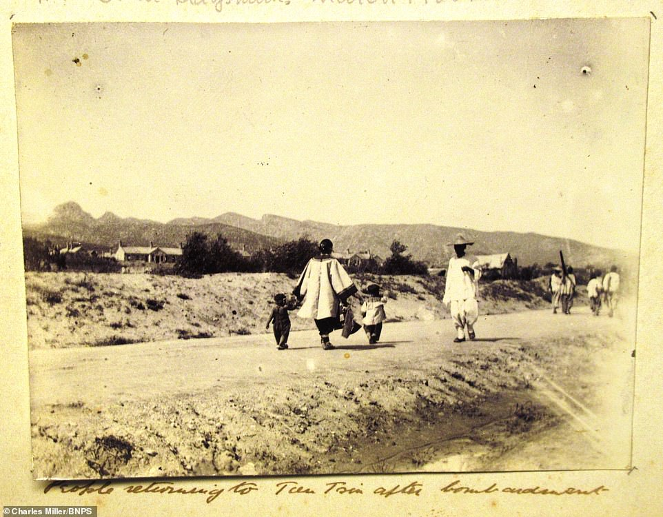 The album, containing 74 photos, also features Dorling's time afterwards in Hong Kong where he took pictures of locals. Above, a woman with two small children can be seen walking as a man in a hat comes her way. Dorling's album, containing 74 photos, has been consigned for sale by a private owner who acquired it from a deceased estate 10 years ago with auctioneers Charles Miller, of London. It is tipped to sell for £3,000