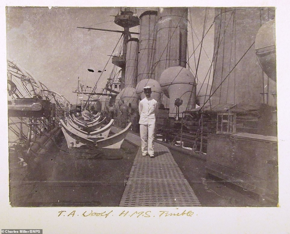 This image shows a sailor, named as T.A. Woolf by Dorling in the photo's caption, standing on board the HMS Terrible. Captain Scott adapted the guns on the ship to allow them to be used on land - so they could support the army in the second Boer War. The army lacked any long-range artillery and had found they were being bested by the weapons the Boers had
