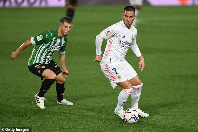 Zinedine Zidane has backed Eden Hazard (right) to 'push on' against Chelsea on Tuesday