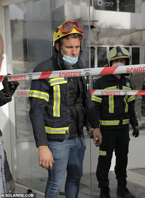 Three fire engines rushed to scene this morning, while Elliott, wearing a firefighter's uniform (pictured), also surveyed damage to his restaurant