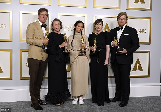 The Best Picture winner Nomadland grossed just $2.5 million. Pictured: Producer Peter Spears, Frances McDormand, director Chloe Zao, Mollye Asher and Dan Janvey