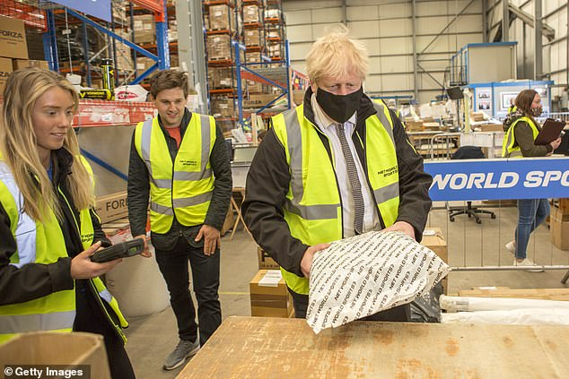 Mr Johnson, pictured during a visit to a warehouse in Wrexham today, insisted the Government is 'working very hard' to secure her release as he said officials and ministers will 'redouble our efforts'.