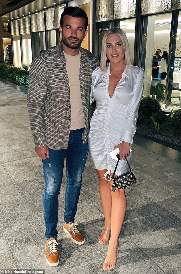 Romance: Mike posed with his girlfriend, whose identity is unknown, calling her 'my girl' while dining at another celebrity hot spot in Dubai