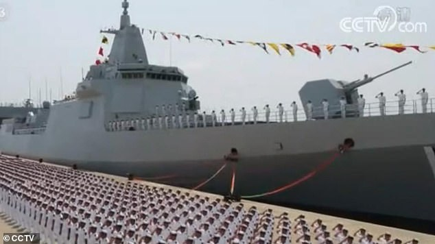 Xi flexed his military muscles in the South China Sea by unveiling three new warships in a ceremony on Friday