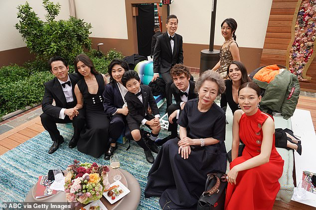 Stars of the film Minari, including Oscar winnerYoun Yuh-jung, relax after the award ceremony in Los Angeles on Sunday