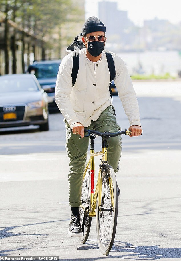 Cruisin' along:The actor, 49, managed to look stylish as he rode a long, wearing a comfy-looking cream jacket and fitted olive green cargo pants