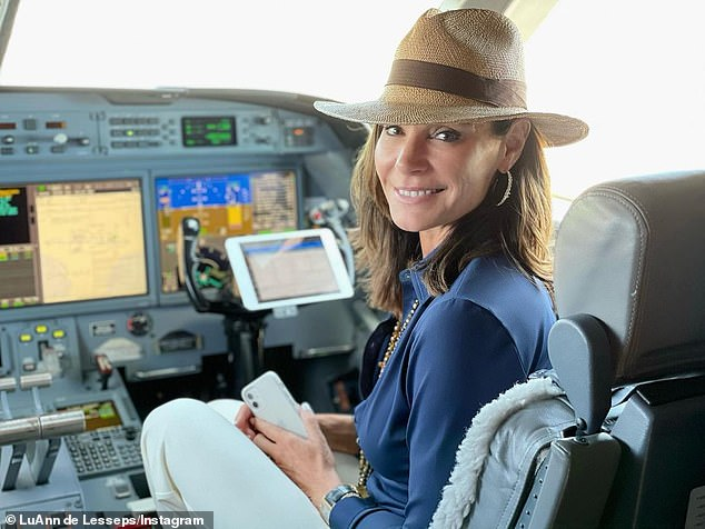 Flying high:Luann shared a shot from the cockpit of her transport, looking over her shoulder and smiling as she captioned the photo: 'Ready for take off?'