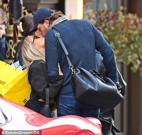 Closer than ever: The couple couldn't keep their hands off one another as they kissed