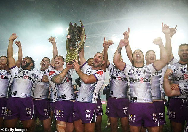The NRL is reportedly considering restructuring the sport to make it more like America's NFL. Pictured: Storm stars Cameron Munster and Cameron Smith celebrate with team mates after winning the 2020 NRL