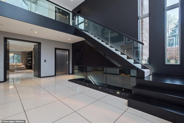 Class of 92 star Neville previously tried to sell the property for £4.5m in 2015 when he moved to Valencia as assistant to his brother Gary (atrium pictured)