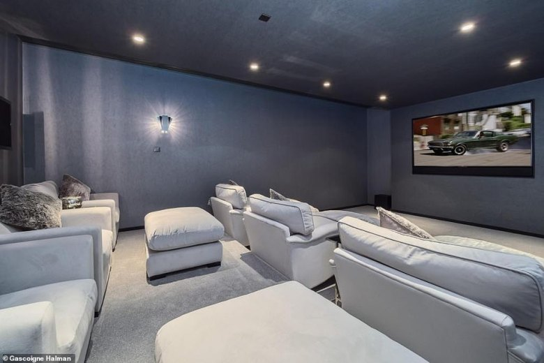 The 10,000 square foot family home - which Neville has shared with wife Julie and their two children - is set over four floors (cinema pictured)