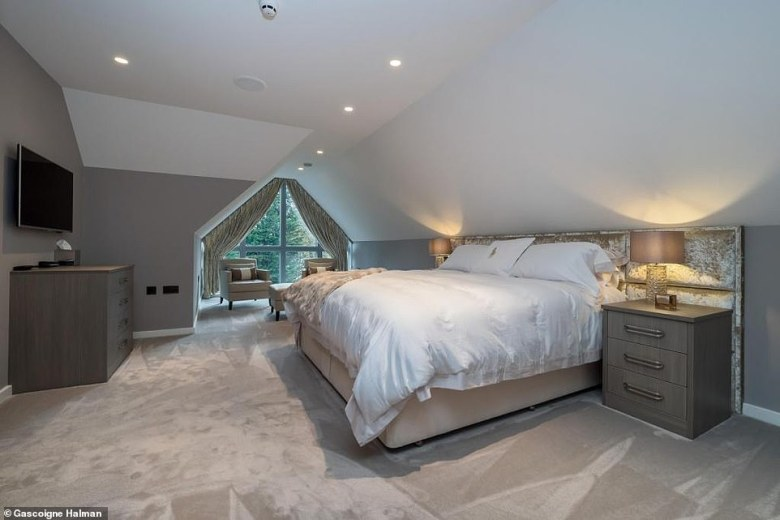 The 10,000 square foot family home - which Neville has shared with wife Julie and their two children - is set over four floors (one of the six bedrooms pictured)