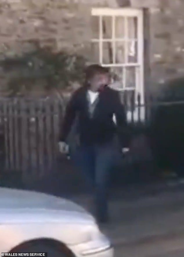 Richard Hammond steps out of his car after trying to squeeze it into a small parking spot on a residential street in Crickhowell, Wales, during a staged incident for his show