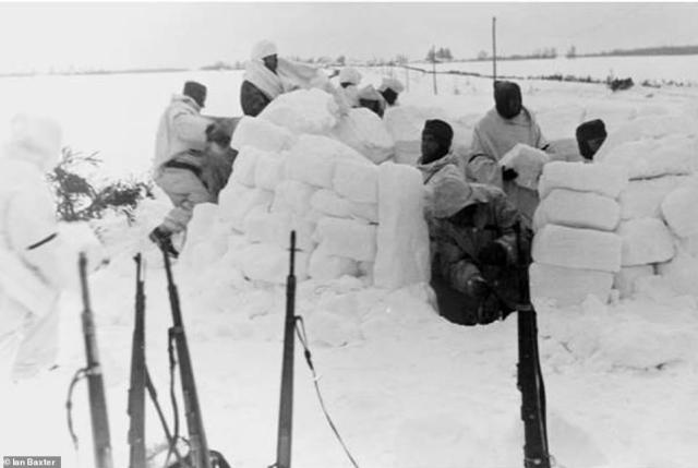 The handbook given to troops also gave instructions on how to build various types of shelter, including igloos. The guide also spoke of the alleged advantages of winter warfare, including that it was particularly easy to dig trenches, shelters and build walls of snow to use as wind breakers. Pictured: Troops building an igloo according to the guide's specifications