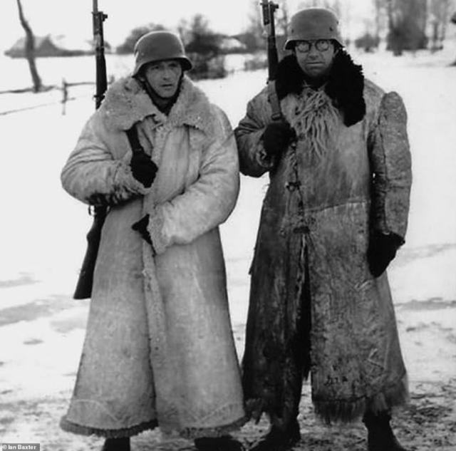 Two German soldiers are seen above wearing greatcoats made from animal skins. The coats, which varied in size and quality, were intended for use in extremely cold climates. Although they were normally worn by officers, ordinary men were also seen wearing them, especially during stints standing still while on guard duty