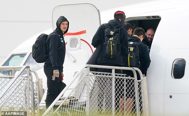 Dustin Martin (left) could be about to get on a plane to New Zealand to visit his dad, thanks to the Trans-tasman travel bubble