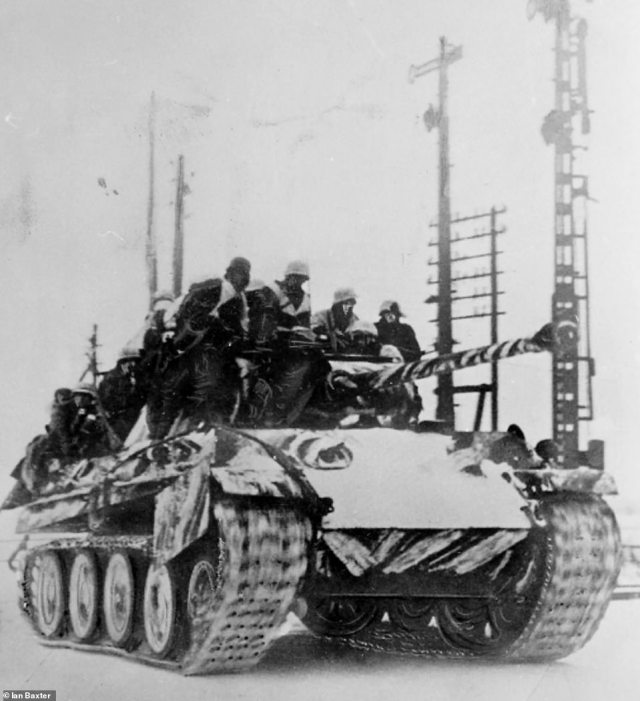 Troops are seen dressed in their winter parkas as they hitch a lift on board a tank. It is clear that the tank has been involved in combat because it is missing part of its side skirt. On January 26, 1944, the city of Leningrad was liberated from German troops after a 900-day siege. It was the start of the crumbling of the German northern front