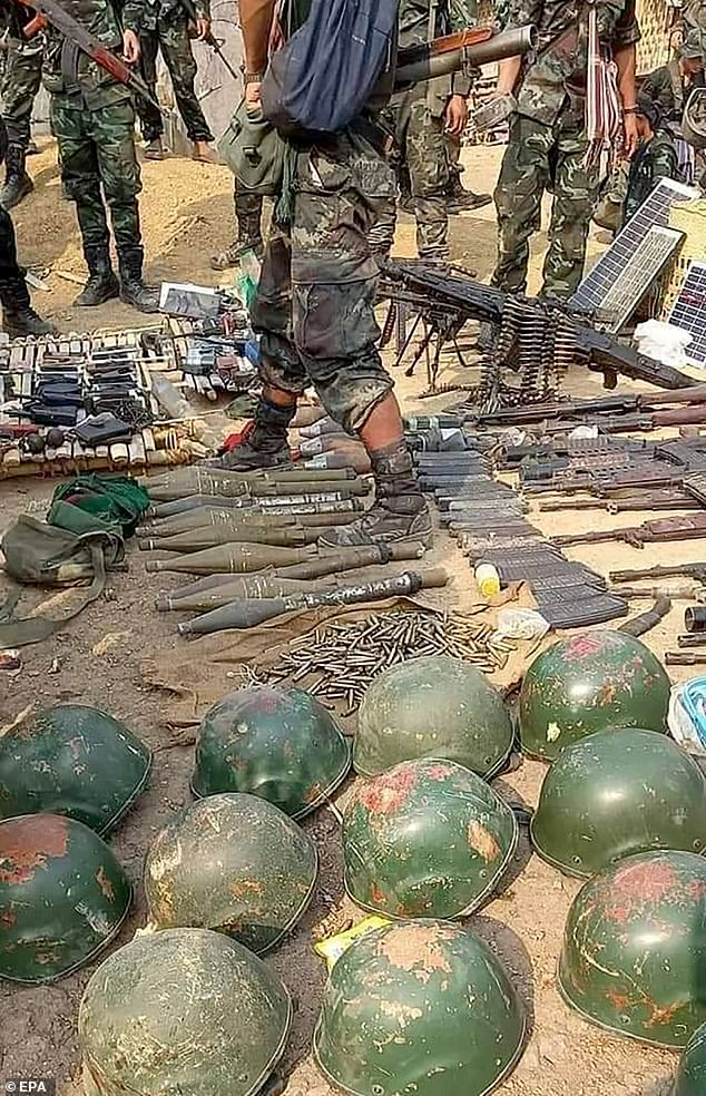 A KNU handout photo shows Myanmar's military helmets and weapons seized by the guerrillas following a clash on Tuesday